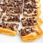 Fantastic Cookie Bars - A puff pastry crust is a delicious way to add a sophisticated twist to those kid-favorite, chocolate-coconut cookie bars.  Serve them at your next party, because this version will be loved by adults and kids alike!