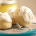 Italian Lemon Drop Cookies - Little lemon cookies topped with lemon frosting are tart, tangy, and irresistible.