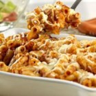 Baked Ziti - Short tube-shaped pasta tossed with seasoned tomato sauce, mozzarella and Parmesan cheeses is baked in a casserole until bubbling.