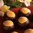 JIF(R) Buckeyes - Peanut butter balls are dipped in chocolate to resemble buckeyes.