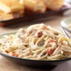Swanson(R) Chicken Tetrazzini - Red pepper and chopped parsley brighten up the creamy mushroom and Parmesan sauce that brings this chicken and pasta dish together.