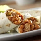 Campbell's(R) Chicken and Bean Burritos - These quick and tasty burritos feature a zesty combination of Campbell's(R) Condensed Bean with Bacon Soup, Pace(R) Thick and Chunky Salsa and Swanson(R) Premium Chunk Chicken, heated and served inside warmed flour tortillas.
