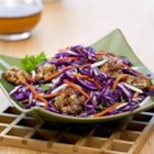 Asian Coleslaw with Candied Walnuts - This colorful coleslaw with shredded jicama is tossed with a citrus and ginger dressing then topped with candied walnuts.