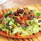 Beef Fajita Salad - Hot strips of seasoned beef top this salad dressed with Southwest Fiesta Dressing.