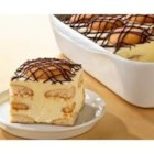 Chocolate Eclair Squares - Alternating layers of vanilla wafers and creamy vanilla pudding mixture are topped with more wafers and drizzled with melted chocolate.