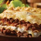 Hearty Lasagna - This classic lasagna casserole features ground beef in a perfectly seasoned pasta sauce layered with noodles and traditional Italian cheeses.