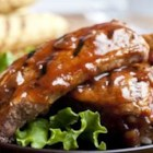 Campbell's(R) Honey Barbecued Ribs - Tender, parboiled ribs are glazed on the grill with a flavorful sweet-and-spicy sauce that features Campbell's(R) Condensed French Onion Soup, ketchup, onion, honey and garlic powder.