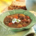 Slow-Cooker Beef and Vegetable Soup - For this hearty stew, beef, carrots, and potatoes simmer all day with a flavorful beef broth mixed with tomato paste and coffee.