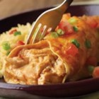 "Campbell's(R) Easy Chicken and Cheese Enchiladas - A creamy filling of chicken, sour cream, and cheese gets an added ""kick"" stirred into it with Pace(R) Picante Sauce. Rolled up in tortillas and baked until bubbly, these enchiladas couldn't be easier, or any more delicious."