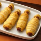 Crescent Mummy Dogs - Hot dogs are all wrapped up in a classic recipe for Halloween...or anytime a chuckle is in order.