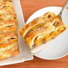 Braided Peach Strudel - Using prepared puff pastry sheets and frozen peach slices makes it so easy to create this mouthwatering peach strudel that tastes even better than it looks!