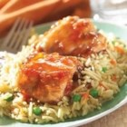Savory Apricot Chicken with Vegetable Rice - Chicken thighs simmered in a sweet-savory sauce are served over piping hot rice with veggies.