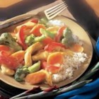 Creamy Chicken Stir-Fry - Sauteed chicken and colorful vegetables are served over hot rice in a savory, cream sauce.