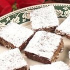 Chewy Noels - These bar cookies make fabulous holiday gifts. Serve them on Christmas Eve with hot buttered rum.  If you desire a cake textured cookie, use an 8x8 inch square pan. Pecans can be substituted for walnuts.