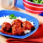 Saucy Porcupine Meatballs - Tender rice-plumped meatballs simmered in a sweet tomato sauce.