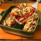 1-Dish Chicken Parmesan - Ready to serve in less than an hour, this one-dish meal layers chicken, marinara sauce and shredded cheese on a yeast bread base for the best flavors of Italy.