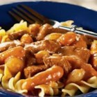 Swanson(R) Greek-Style Beef Stew - This hearty stew features beef cubes, carrots and onions that slowly simmer in a flavorful combination of Swanson(R) Beef Broth, V8(R) Vegetable Juice, brown sugar, bay and cloves.