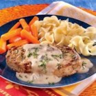 Creamy Mustard Pork Chops - Seasoned, browned pork chops simmer in a creamy mustard-laced mushroom sauce.