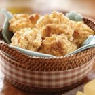 Sugar-Crusted Sweet Potato Biscuits - Drop biscuits are sweetened with mashed sweet potato and a bit of brown sugar with an extra sprinkle on top for a pretty sugar coating.