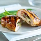 Brie and Sage Stuffed Chicken - Creamy Brie cheese and salty prosciutto transform ordinary grilled chicken breasts into an indulgent, company-worthy dish. For entertaining ease, stuff the chickens up to one day in advance; reserve in the refrigerator until 30 minutes before grilling.
