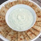 Herbed Goat Cheese Spread - Tangy goat cheese with yogurt, fresh thyme, garlic, and olive oil makes a creamy spread to serve on crisp crackers.