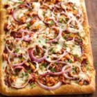 BBQ Chicken Pizza from Pillsbury(R) Artisan Pizza Crust - Treat your family to this warm and delicious BBQ chicken pizza that's made using Pillsbury(R) refrigerated artisan pizza crust with whole grain – perfect for dinner.