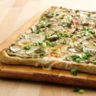 Potato Pesto Pizza - Small red potatoes, mozzarella, garlic and pesto create a pizza that is packed with flavor! Starting with Pillsbury(R) refrigerated artisan pizza crust with whole grain, it's on the table in less than 30 minutes.