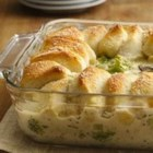 Chicken Alfredo Biscuit Casserole - Your family will run to the dinner table when you make this delicious chicken Alfredo casserole topped with Parmesan-crusted biscuits.