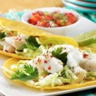 Fish Tacos by Reynolds(R) - Fish fillets are marinated in spices and herbs, baked until tender, then served in tortillas with a creamy sauce and your favorite toppings.
