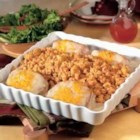 Pork Chops & Stuffing Bake - Pork chops top corn bread stuffing and are laced with a creamy sauce before baking.