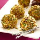 Almond Crusted Chevre and Grape Truffles - A savory-sweet appetizer that looks like a candy truffle is really a juicy grape in a goat cheese coating, rolled in toasted almonds and chives.
