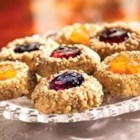 Classic Thumbprint Cookies - Filled with the one-of-a-kind taste of SMUCKER'S(R) preserves or jam, this recipe combines delicious fruit flavor with classic crunch.