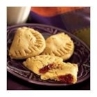Peanut Butter and Jelly Sandwich Surprises - Concord grape jelly is at the sweet center of these heart-shaped peanut butter sandwich cookies.