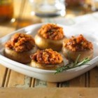 Spicy Sausage Stuffed Mushrooms - Looking for a delicious appetizer to serve at your next cocktail party? These zesty sausage and cheese stuffed mushrooms are sure to be popular with all your guests.
