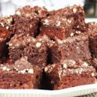 Baked Fudge - A sweet gooey mixture of sugar, flour, cocoa, eggs, butter, vanilla and pecans becomes an irresistible panful of baked rich sweetness.