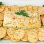 Pesto Cheese Terrine - Three differently flavored layers of cream cheese--lemon and almond, basil pesto, and sun-dried tomato pesto--are chilled and served with crackers for an easy, elegant appetizer spread.