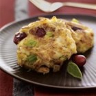 McCormick(R) Cranberry-Sage Mini Crab Cakes - Serve these miniature crab cakes as a holiday appetizer or at brunch. Rubbed sage and orange zest season the crab cake mixture and dried cranberries add festive color.