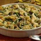 Sister Schubert's(R) Green Bean Casserole - Forget canned veggies! Fresh green beans, along with mushrooms, thyme and Sister Schubert's Parker House Style Rolls, make this one extraordinarily delicious dish.