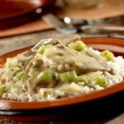 Creamy Pork Saute - Stir-fried pork strips, celery and onion added to a creamy celery sauce crown a bed of rice for a satisfying family supper.