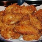 Crispy Fried Chicken Wings - Chicken wings marinate in buttermilk before being pressed into a cayenne-, garlic-, and thyme-spiked cracker breading and fried to a crispy, golden brown.