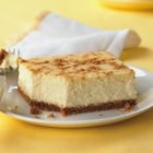 PHILLY Lemon Cheesecake - A light layer of of graham cracker crumbs adds a bit of crunch to the top of this luscious lemon cheesecake.