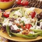 Grilled Chicken, Tomato and Baby Greens Salad with Blue Cheese - Grilled chicken is sliced and tossed with fresh salad greens, tomatoes, bacon bits and blue cheese, then dressed with creamy blue cheese dressing.