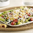 Southwest Salad - Shake up your summer salad roster and try this new Southwest style salad. Sweet crisp fresh corn paired with Habanero spiked shredded cheese are the perfect balance of sweet and heat.