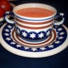 Cream of Fresh Tomato Soup - Tomato stock is thickened with a roux and combined with milk to create this flavorful soup.