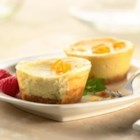 Maille(R) Mini Cheesecakes - Mini cheesecakes with a touch of orange and honey mustard are a sweet, creamy treat topped with fresh berries.