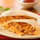 Chicken Enchilada Foldovers - Four easy ingredients, and you've got dinner! Wrap a spicy chicken filling with pizza crust.