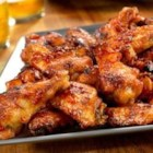 Picante-Glazed Chicken Wings - Getting bored with buffalo wings? Give these flavor-packed wings a try...they're baked instead of fried, and they're glazed with a sweet and spicy sauce that's out of this world!
