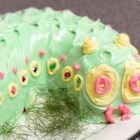 "Caterpillar Cake - ""This is a great cake to do after a unit on bugs, wildlife, etc. Have the kids help decorate it! Use licorice whips for antennas, or gumdrops. Spread icing around caterpillar and sprinkle green tinted coconut for grass. Use any flavor cake mix or any Bundt cake recipe."""