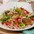 Spicy Thai Pork with Vegetables and Sesame Noodles - Pork tenderloin is roasted with peanut sauce, sugar snap peas, and bell pepper and served with sesame-seasoned ramen noodles.