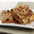 Magic Cookie Bars from EAGLE BRAND(r) - This bar cookie is an old fashioned favorite. Chocolate chips, nuts and coconut are set in a caramelized layer on top of a graham cracker crust.